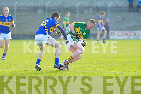 Kerry's captain Dara O Se holds of the challenge of Tipperary's Dylan Fitzell in the Munster minor football championship at Austin Stack park, Tralee on Saturday.
