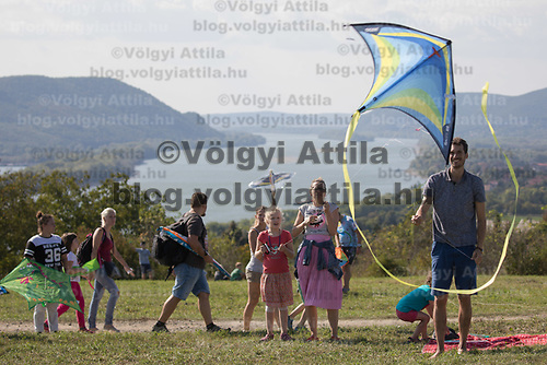 People participate flying their kites during the Kite Festival with the view of River Danube in the background in Zebegeny (about 70 kilometres north of capital city Budapest), Hungary on Sept. 15, 2018. ATTILA VOLGYI