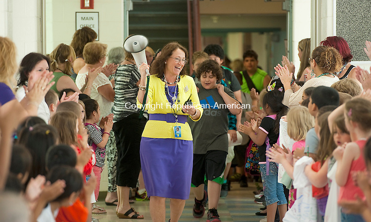 TORRINGTON, CT-061814JS03--Pamela Dzurilla, principal of Vogel-Wetmore School, leads members of the fifth grade class out to the busses for the last time on Wednesday. Along with it being the last day for school, it is the last day for Dzurilla, who had been principal at the school for nine years and is retiring after more than 30 years in the district.  <br /> Jim Shannon Republican-American
