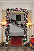 "Washington, DC - December 3, 2008 -- Green garland featuring a patriotic ribbon, snow, and red beads surrounds the entrance to the Grand Staircase during a media preview of the 2008 holiday decorations and tasting event on the State Floor of the White House in Washington, D.C. on Wednesday, December 3, 2008.  The theme of this years decorations is ""a Red, White, and Blue Christmas""..Credit: Ron Sachs / CNP"