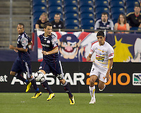 Goal scorer New England Revolution midfielder Marko Perovic (29) controls the ball as Monarcas Morelia defender Enrique Perez (2) closes. The New England Revolution defeated Monarcas Morelia in SuperLiga 2010 group stage match, 1-0, at Gillette Stadium on July 20, 2010.