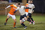 Hank Gauger (23) of the Wake Forest Demon Deacons keeps the ball away from Patrick Bunk-Andersen (3) of the Clemson Tigers during first half action at Spry Soccer Stadium on November 8, 2017 in Winston-Salem, North Carolina.  The Demon Deacons defeated the Tigers 2-1.  (Brian Westerholt/Sports On Film)