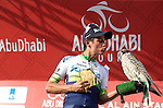 Esteban Chavez (COL) Orica GreenEdge attempts to kiss the podium bird after winning Stage 3, The Al Ain Stage, of the 2015 Abu Dhabi Tour starting from the Al Qattara Souq in Al Ain and running 129 km to the mountain top finish at Jebel Hafeet at 1025 metres, Abu Dhabi. 10th October 2015.<br /> Picture: ANSA/Claudio Peri | Newsfile