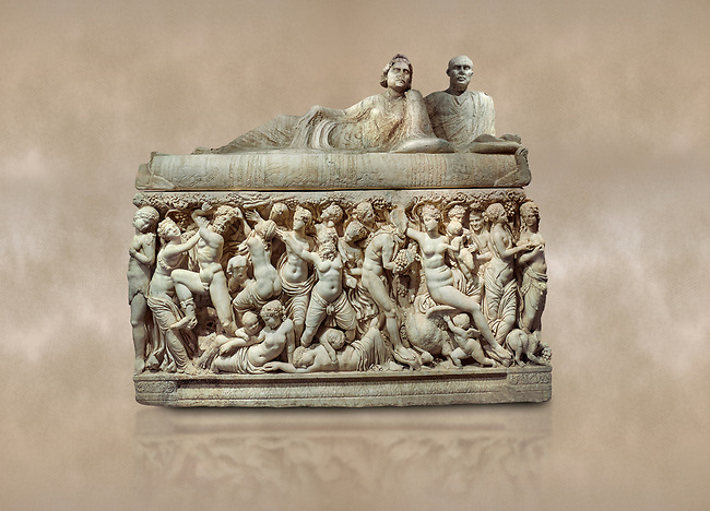 "Roman relief sculpted sarcophagus depicting a scene with Dionysus made in a Greek Attica workshop, 3rd century AD, Perge Inv 1.35.99. Antalya Archaeology Museum, Turkey.<br /> <br /> The lid of the sarcophagus is sculpted into the form of a ""Kline"" style Roman couch on which lie Julianus &  Philiska. This type of Sarcophagus is also known as a Sydemara Type of Tomb.. Against a warm art background."