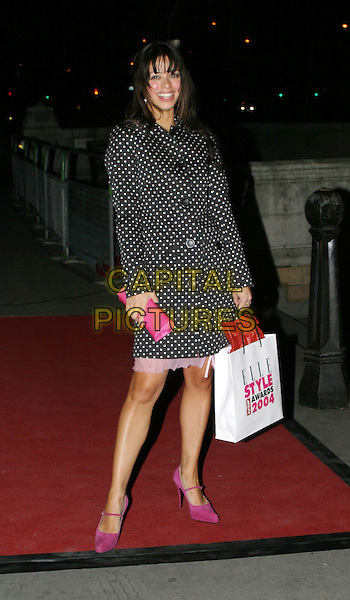 TINA BARRETT.Elle Style Awards 2004 at the Natural History Museum.16 February 2004.full length, full-length, black polka dot spotty coat, goodie bag, goody bag, pink handbag shoes, heels.www.capitalpictures.com.sales@capitalpictures.com.© Capital Pictures.