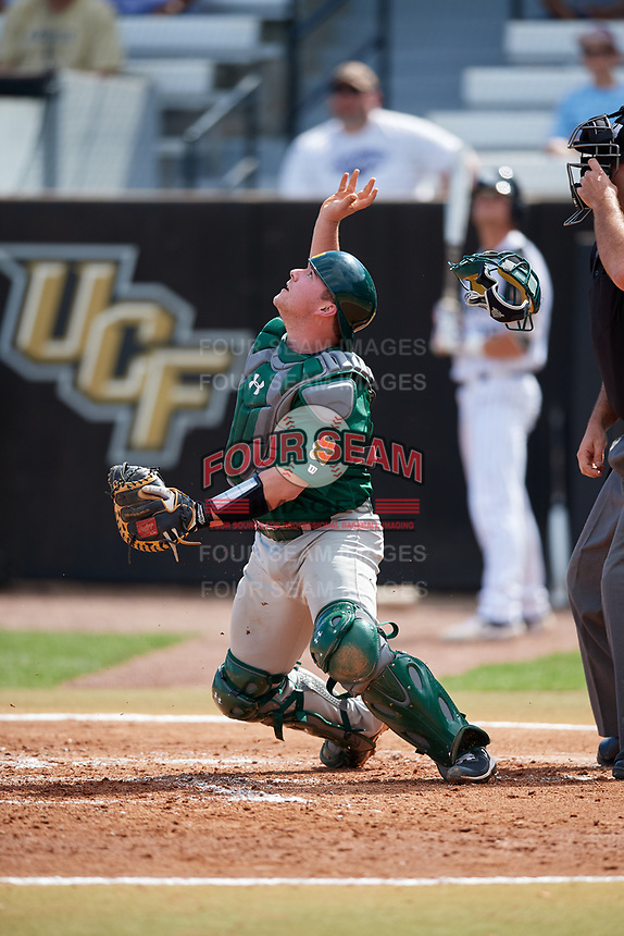 Siena Saints catcher Alex Milone (10) tracks a pop up during a game against the UCF Knights on February 17, 2019 at John Euliano Park in Orlando, Florida.  UCF defeated Siena 7-1.  (Mike Janes/Four Seam Images)