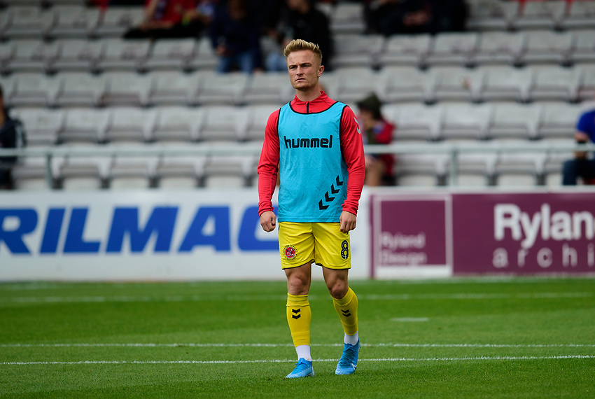 Fleetwood Town's Kyle Dempsey during the pre-match warm-up<br /> <br /> Photographer Andrew Vaughan/CameraSport<br /> <br /> The EFL Sky Bet League One - Lincoln City v Fleetwood Town - Saturday 31st August 2019 - Sincil Bank - Lincoln<br /> <br /> World Copyright © 2019 CameraSport. All rights reserved. 43 Linden Ave. Countesthorpe. Leicester. England. LE8 5PG - Tel: +44 (0) 116 277 4147 - admin@camerasport.com - www.camerasport.com