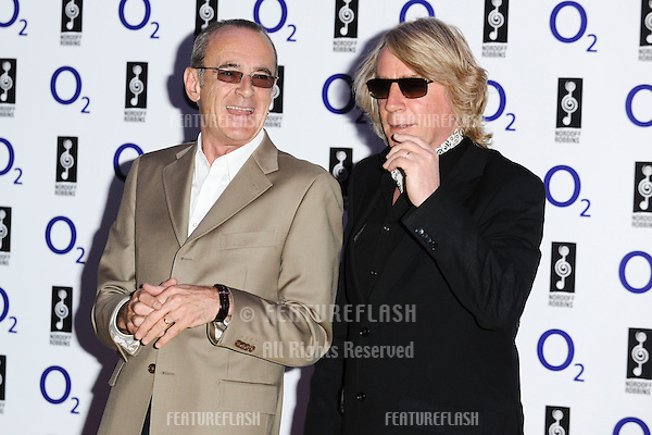 Status Quo arrives for the Silver Clef Awards 2011 at the Park ane Hilton, London. 01/07/2011 Picture by: Steve Vas / Featureflash