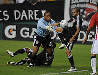 DC United midfielder Fred (7) tries to shoot on goal against Chivas USA goalkeeper Zach Thornton (22).  Chivas USA defeated DC United 2-0  at RFK Stadium, Saturday October 3, 2009.