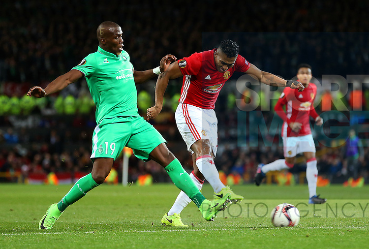 Luis Antonio Valencia of Manchester United fires a shot at goal under pressure from Florentin Pogba of Saint Etienne during the UEFA Europa League Round of 32 1st leg match at Old Trafford Stadium, Manchester. Picture date: February 16th, 2017. Pic credit should read: Matt McNulty/Sportimage