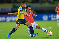 PEREIRA, COLOMBIA - JANUARY 18: Chile's Ivan Morales, (R) fights for the ball  against Ecuador's Jackson Porozo during their CONMEBOL Preolimpico soccer game at the Hernan Ramirez Villegas Stadium on January 18, 2020 in Pereira, Colombia. (Photo by Daniel Munoz/VIEW press/Getty Images)