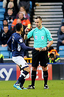 Referee Stuart Attwell shows a yellow card to Millwall's Tim Cahill during Millwall vs Brentford, Sky Bet EFL Championship Football at The Den on 10th March 2018