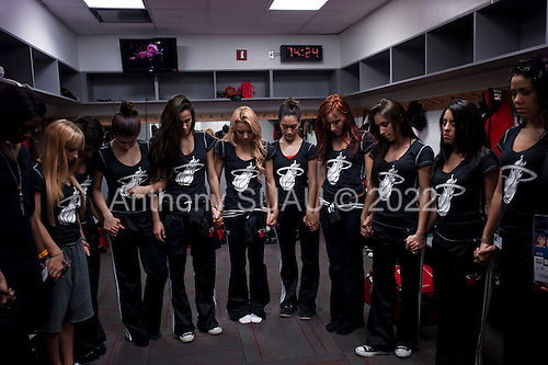Miami, Florida<br /> January 29, 2012<br /> <br /> Miami Heat Dancers hold a collective prayer in their dressing room minutes before the game between the Chicago BULLS and the Miami HEAT.