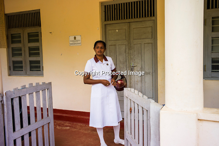 Mathumita prepares to go out on field visits in Punaineeravi village in Kilinochchi in Northern Sri Lanka. Photo: Sanjit Das/Panos
