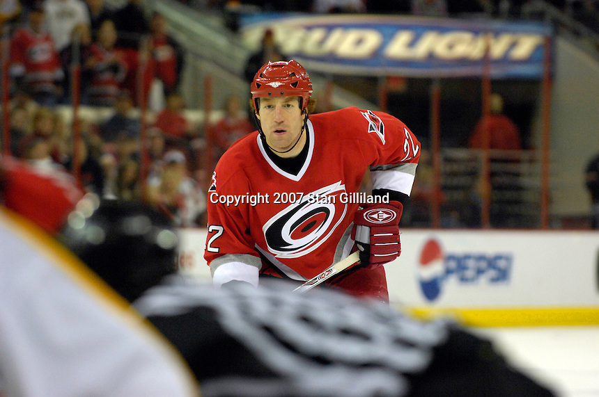 Carolina Hurricanes' Mike Commodore watches a faceoff with the Boston Bruins Saturday, Feb. 3, 2007 at the RBC Center in Raleigh. Boston won 4-3 in overtime.