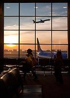 Sunrise through an airport window. (Darren Abate/pressphotointl.com)