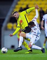 Phoenix's Gary Hooper and Perth's Kristian Popovic comepete for the ball during the A-League football match between Wellington Phoenix and Perth Glory at Westpac Stadium in Wellington, New Zealand on Sunday, 27 October 2019. Photo: Dave Lintott / lintottphoto.co.nz