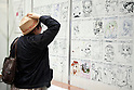 "A woman looks at the various draws on display at the Niconico Douga fan event at Makuhari Messe International Exhibition Hall on April 25, 2015, Chiba, Japan. The event includes special attractions such as J-pop concerts, Sumo and Pro Wrestling matches, cosplay and manga and various robot performances and is broadcast live on via the video-sharing site. Niconico Douga (in English ""Smiley, Smiley Video"") is one of Japan's biggest video community sites where users can upload, view, share videos and write comments directly in real time, creating a sense of a shared watching. According to the organizers more than 200,000 viewers for two days will see the event by internet. The popular event is held in all 11 halls of the huge Makuhari Messe exhibition center from April 25 to 26. (Photo by Rodrigo Reyes Marin/AFLO)"