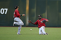 A hit lands in between Arizona Diamondbacks shortstop Isan Diaz (6) and outfielder Marcus Wilson (8) during an Instructional League game against the Oakland Athletics on October 10, 2014 at Chase Field in Phoenix, Arizona.  (Mike Janes/Four Seam Images)