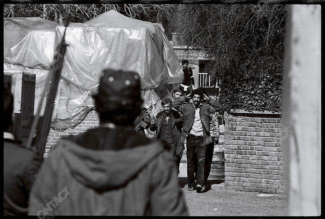 Gunmen escort a marine out of the U.S. Embassy..Tehran, February 14, 1979