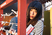 A young lady with a guide book in Asakusa, Tokyo.