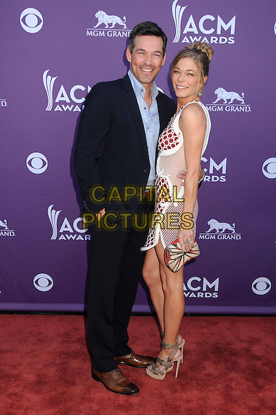 Eddie Cibrian, LeAnn Rimes.47th Annual Academy of Country Music Awards held at the MGM Grand, Las Vegas, Nevada, USA..April 1st, 2012.full length black suit blue shirt white red maroon burgundy one shoulder sheer dress couple side polka dot print pattern ACM CMA.CAP/ADM/BP.©Byron Purvis/AdMedia/Capital Pictures.