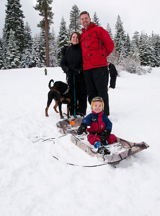 California, Lake Tahoe: Young family with child and dog enjoy snow play with sled at North Lake Tahoe Regional Park.  Photo copyright Lee Foster.  Photo # cataho107522