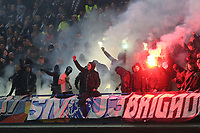 Malmo FF fans light up some flares as the players come onto the pitch for the second half during Chelsea vs Malmo FF, UEFA Europa League Football at Stamford Bridge on 21st February 2019