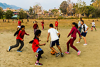 Girls and boys playing soccer, Lakeside, Pokhara, Nepal.