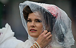 LOUISVILLE, KY - MAY 05: A woman wears a poncho to protect her Derby hat from the downpour on Kentucky Derby Day at Churchill Downs on May 5, 2018 in Louisville, Kentucky. (Photo by Alex Evers/Eclipse Sportswire/Getty Images)