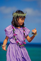 Young Leigh dancing hula at beach