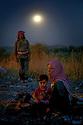 Syria 2014  <br /> August 15, a family waiting by night their relatives before crossing the Pesh Kabour's bridge to reach the Kurdistan of Iraq  <br /> Syrie 2014 <br /> 15 aout, la nuit, une famille attendant le reste de leur famille avant de traverser le pont de Pesh Kabur pour entrer au Kurdistan irakien.