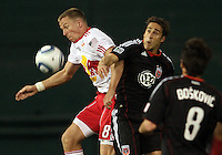 Josh Wolfe (16) of D.C. United and Jan Gunnar Solli (8) of the New York Red Bulls go up for a high ball during an MLS match at RFK Stadium, in Washington D.C. on April 21 2011. Red Bulls won 4-0.
