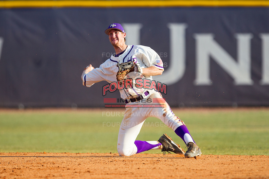 High Point Panthers shortstop Tony Fortier-Bensen (8) makes a throw from his knees against the Bowling Green Falcons at Willard Stadium on March 9, 2014 in High Point, North Carolina.  The Falcons defeated the Panthers 7-4.  (Brian Westerholt/Four Seam Images)