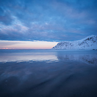 Soft winter light reflecting on Skagsanden beach, Flakstadøy, Lofoten Islands, Norway
