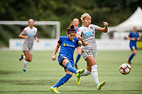 Seattle, WA - Sunday, August 13, 2017: Jaelene Hinkle and Nahomi Kawasumi during a regular season National Women's Soccer League (NWSL) match between the Seattle Reign FC and the North Carolina Courage at Memorial Stadium.