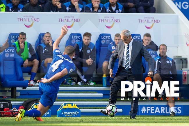 Leicester City Manager Claudio Ranieri controls the ball as Daniel Drinkwater of Leicester City  raises his arm during the Premier League match between Leicester City and Southampton at the King Power Stadium, Leicester, England on 2 October 2016. Photo by Andy Rowland.