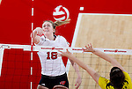 Wisconsin Badgers Elle Ohlander (18) hits the ball during an NCAA volleyball match against the Michigan Wolverines at the Field House on October 30, 2010 in Madison, Wisconsin. Michigan won the match 3-1. (Photo by David Stluka)