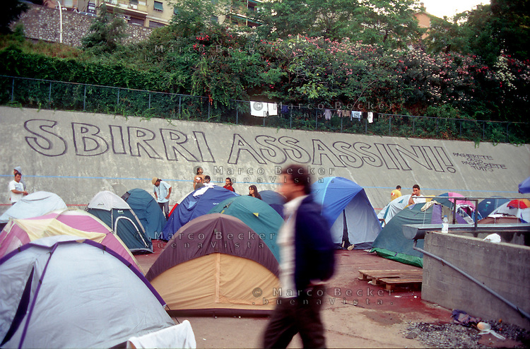 "genova luglio 2001, proteste contro il g8. allo stadio carlini, una scritta per carlo giuliani, ucciso dalla polizia --- genoa july 2001, protests against g8 summit. carlini stadium, a writing for carlo giuliani, killed by the police: ""murderous cops! you will pay costly, you will pay everything"""