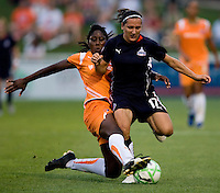 Washington Freedom forward (17) Lisa DeVanna has the ball tackled away from her by  Sky Blue FC defender (5) Anita Asante at the Maryland SoccerPlex in Boyds, Maryland.  The Washington Freedom defeated Sky Blue FC, 3-1, to secure a place in the playoffs.