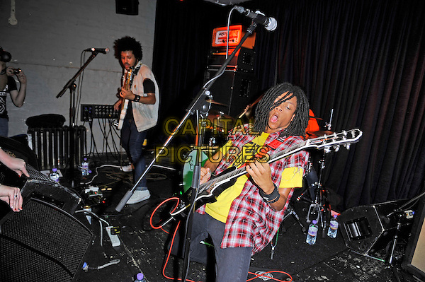 Isaiah Radke and Dee Radke of Radkey <br /> performing in concert, The Blackeart, Camden, London, England. <br /> 17th October 2013<br /> on stage in concert live gig performance performing music half length white jean denim jacket sleeveless bass guitar red check shirt yellow <br /> CAP/MAR<br /> &copy; Martin Harris/Capital Pictures
