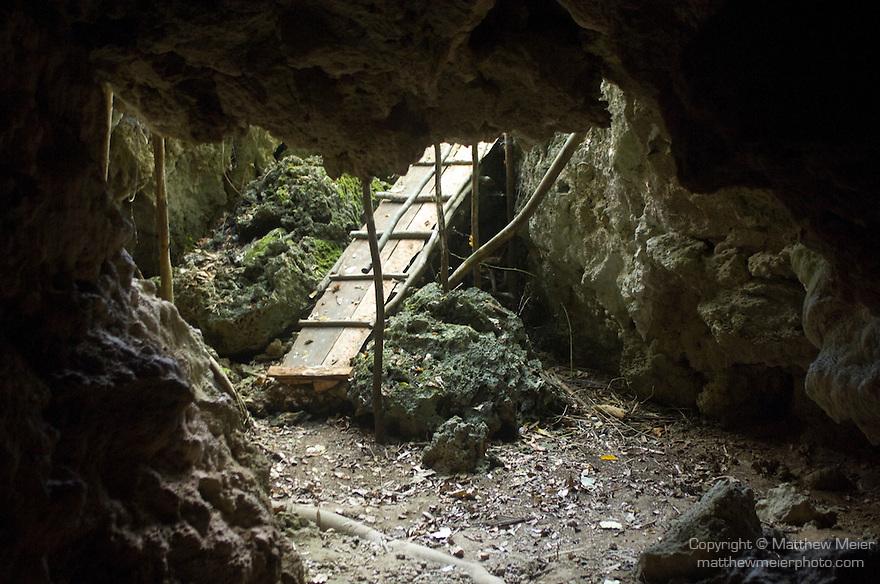 Milne Bay, Papua New Guinea; entrance to skull cave , Copyright © Matthew Meier, matthewmeierphoto.com