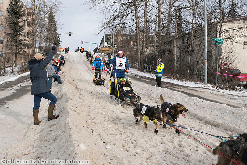 Dag Torulf Olsen and team run past spectators on the bike/ski trail with an Iditarider in the basket during the Anchorage, Alaska ceremonial start on Saturday, March 5, 2016 Iditarod Race. Photo by O'Hara Shipe/SchultzPhoto.com