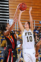 25 November 2011:  FIU guard Fanni Hutlassa (10) attempts to shoot over Maryland guard-forward Alyssa Thomas (25) in the second half as the University of Maryland Terrapins defeated the FIU Golden Panthers, 84-52, at the U.S. Century Bank Arena in Miami, Florida.
