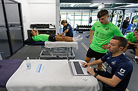 Pictured: Liam Cullen (2nd R) looks on the laptop screen with one of the physiotherapists. Thursday 27 June 2019<br /> Re: Swansea City FC players report for training at Fairwood training ground, UK