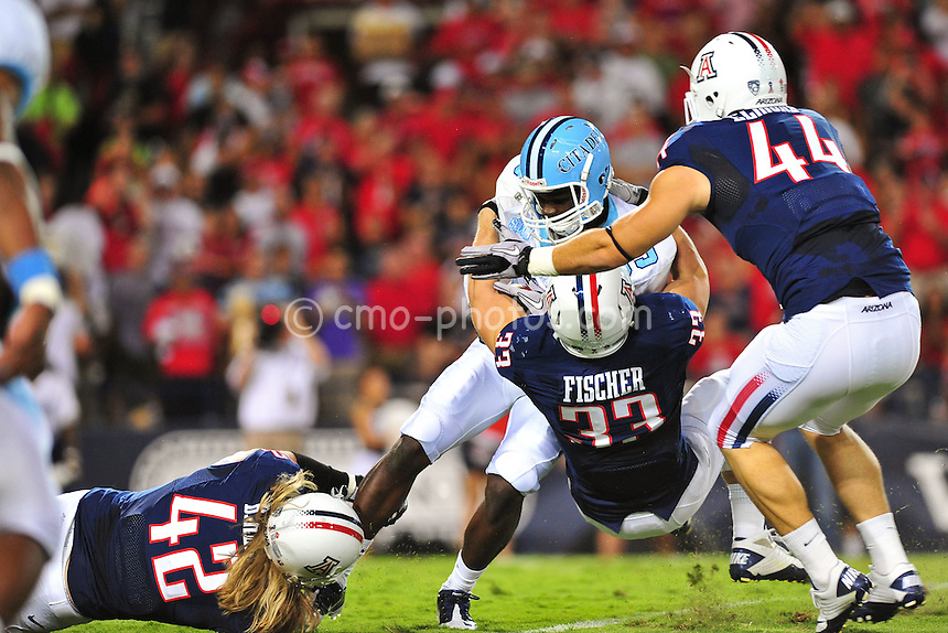 Sept 11, 2010; Tucson, AZ, USA; Citadel Bulldogs player is tackled by Arizona Wildcats defensive end Brooks Reed (42), linebacker Jake Fischer (33), and defensive end Ricky Elmore (44) in the 1st quarter of a game at Arizona Stadium. Arizona won the game 52-6.