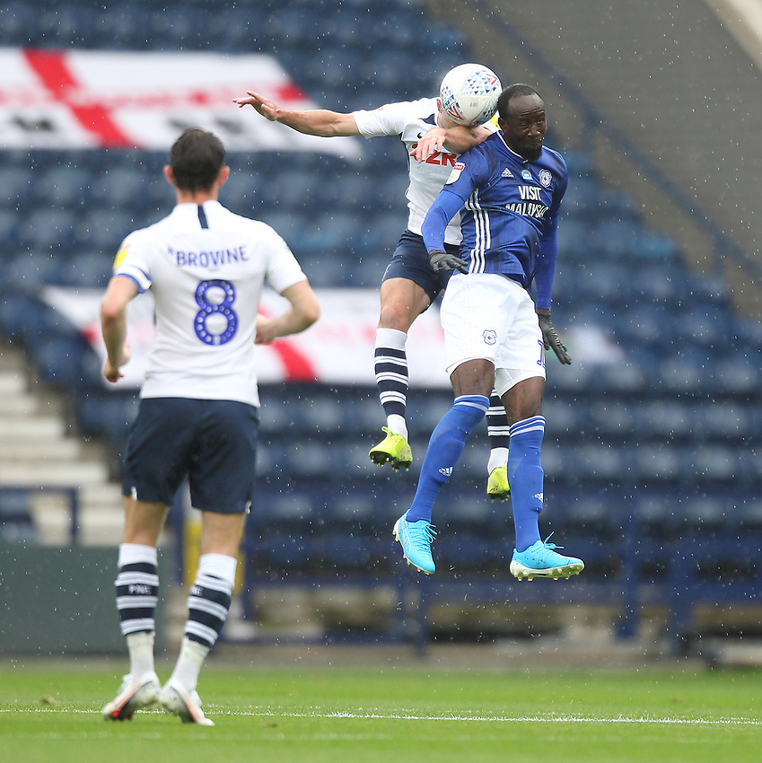 Preston North End's Andrew Hughes  jumps with Cardiff City's Albert Adomah<br /> <br /> Photographer Mick Walker/CameraSport<br /> <br /> The EFL Sky Bet Championship - Preston North End v Cardiff  City - Saturday 27th June 2020 - Deepdale Stadium - Preston<br /> <br /> World Copyright © 2020 CameraSport. All rights reserved. 43 Linden Ave. Countesthorpe. Leicester. England. LE8 5PG - Tel: +44 (0) 116 277 4147 - admin@camerasport.com - www.camerasport.com
