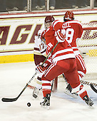 Patch Alber (BC - 27), Charlie Coyle (BU - 3), Sahir Gill (BU - 28) - The Boston College Eagles defeated the visiting Boston University Terriers 5-2 on Saturday, December 4, 2010, at Conte Forum in Chestnut Hill, Massachusetts.