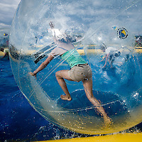 On the Jamboree there are big rolling balls in the water pool. It's funny but not so easy as you fist think. Photo: Jonas Elmqvist/Scouterna