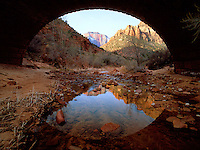 Art in Nature 9601-0222 - Picturesque view of Zion National Park, framed by a highway bridge overpass and reflected in a small stream. St. George, Utah.